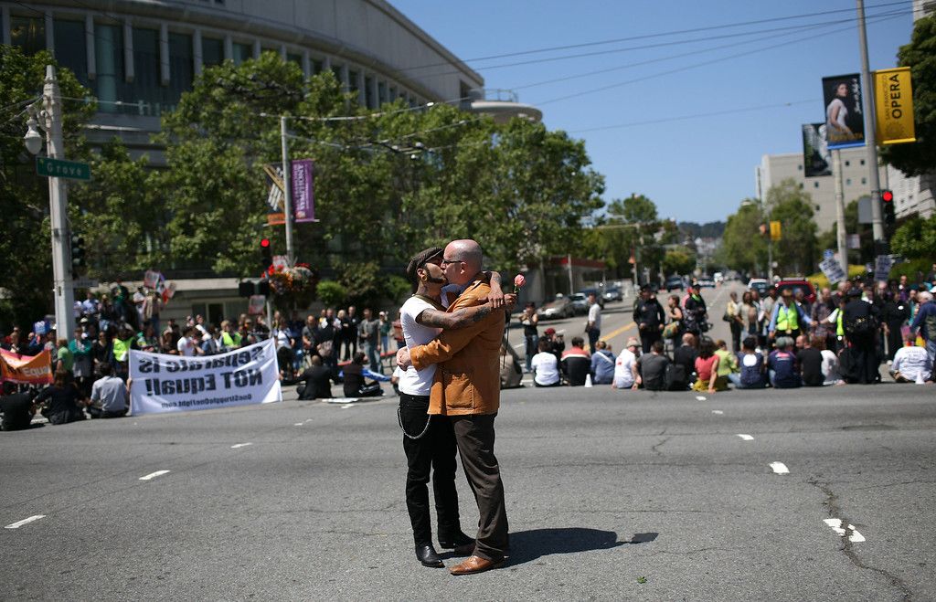 . SAN FRANCISCO - MAY 26:  Same-sex couple Shawn Higgins (R) and his partner Robert Franco kiss as they stand on Van Ness Avenue following the California Supreme Court\'s ruling to uphold Proposition 8 May 26, 2009 in San Francisco, California. The California State Supreme Court voted 6-1 to uphold proposition 8 which makes it illegal for same-sex couples to marry in the state of California. More than 18,000 same-sex couples that wed before prop 8 was voted in will still be legally married.  (Photo by Justin Sullivan/Getty Images) *** Local Caption *** Shawn Higgins;Robert Franco