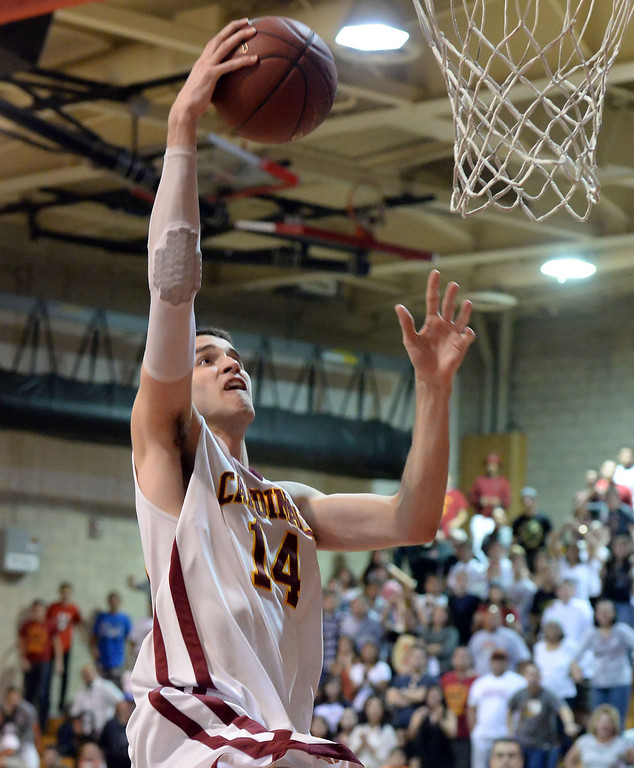 . Cantwell\'s Balsa Dragovic scores against Village Christian in the second half of a State Division 4 CIF Prep Playoff Basketball game at Whittier High School in Whittier, Calif., on Saturday, March 15, 2014. Cantwell won 51-48.  (Keith Birmingham Pasadena Star-News)