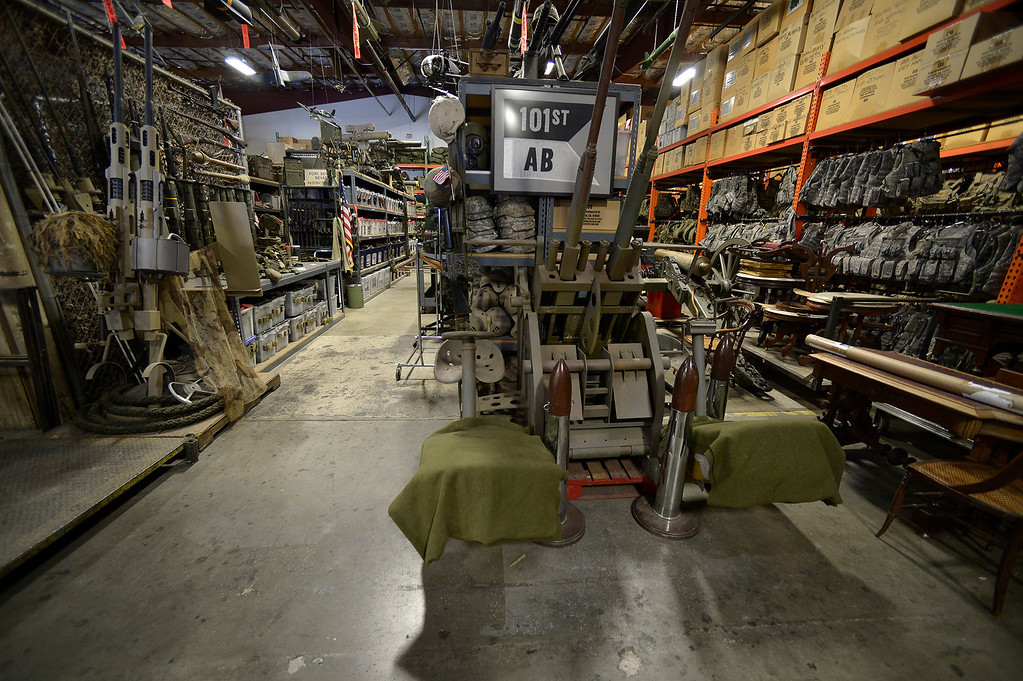 . Military items from nearly every war can be found in the prop house owned by Gregg Bilson, Jr. is the CEO of ISS Independent Studio Services, a prop house that holds hundreds of thousands of items used for motion pictures and television production. Runaway production has an impact on his business. Sunland, CA 12-31-2013. photo by (John McCoy/Los Angeles Daily News)