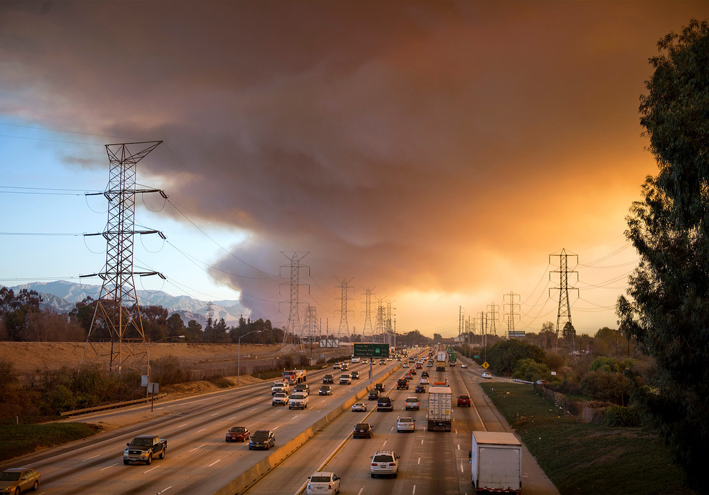 . A massive plume of smoke rises from Colby Fire burning in the Angeles National Forest and Glendora, Calif. is pictured from the Rose Hills Road overpass of the 605 Freeway in Pico Rivera, Calif. Jan. 16, 2014.  (Staff photo by Leo Jarzomb/San Gabriel Valley Tribune)