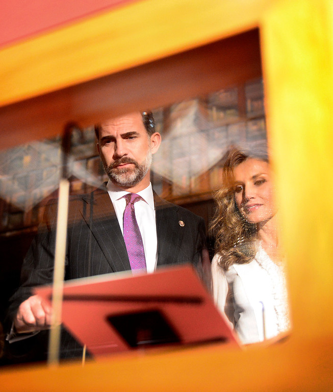 . The Crown Prince Felipe and Princess Letizia of Spain look over historical documents in The Huntington Library\'s Exhibition Hall as they visit the Junipero Serra exhibition in San Marino Saturday night, November 16, 2013. (Photo by Sarah Reingewirtz/Pasadena Star-News)