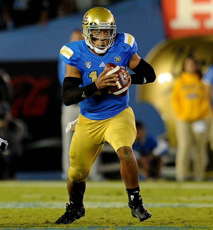 . UCLA quarterback Brett Hundley (17) scrambles during the second half of their college football game against California in the Rose Bowl in Pasadena, Calif., on Saturday, Oct. 12, 2013.   (Keith Birmingham Pasadena Star-News)