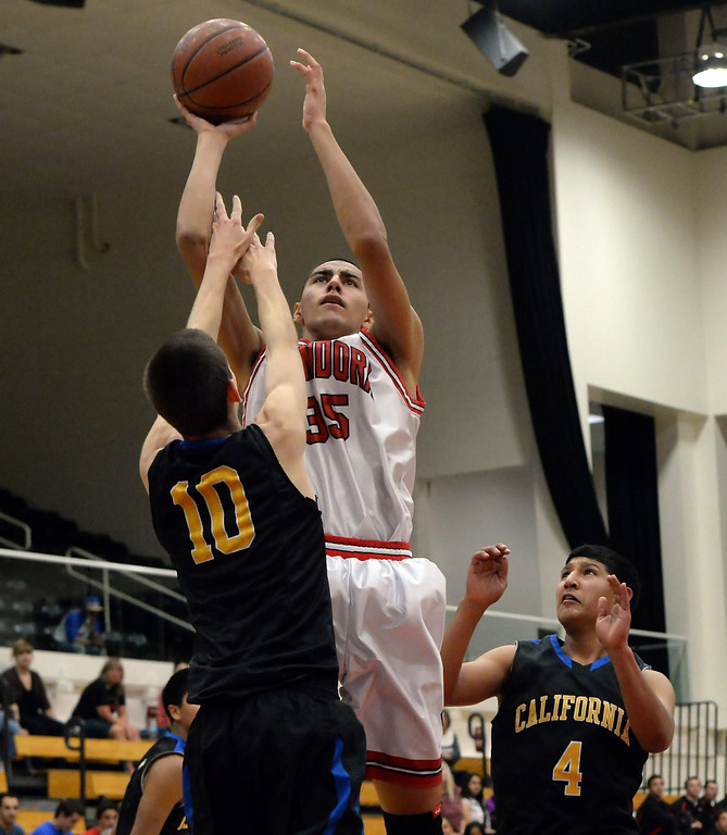 . Glendora\'s Joseph Alvarez (35) shoots over California\'s Brady Gravitt (10) in the first half of a prep basketball game during the SoCal Shootout in the Felix Event Center on the west campus of Azusa Pacific University in Azusa, Calif., on Saturday, Jan. 18, 2014. (Keith Birmingham Pasadena Star-News)