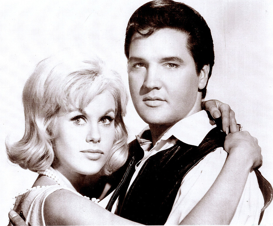 ". Suzanna Leigh embraces Elvis Presley in a publicity photo from the 1966 film ""Paradise, Hawaiian Style.\"" Leigh was one of Presley\'s many female co-stars and is organizing a gathering of actors, actresses and others who worked on Presley\'s movies. The gathering is scheduled to be held in Memphis, Tenn. to mark the 30th anniversary of Presley\'s death. (AP Photo/courtesy Suzanna Leigh)"