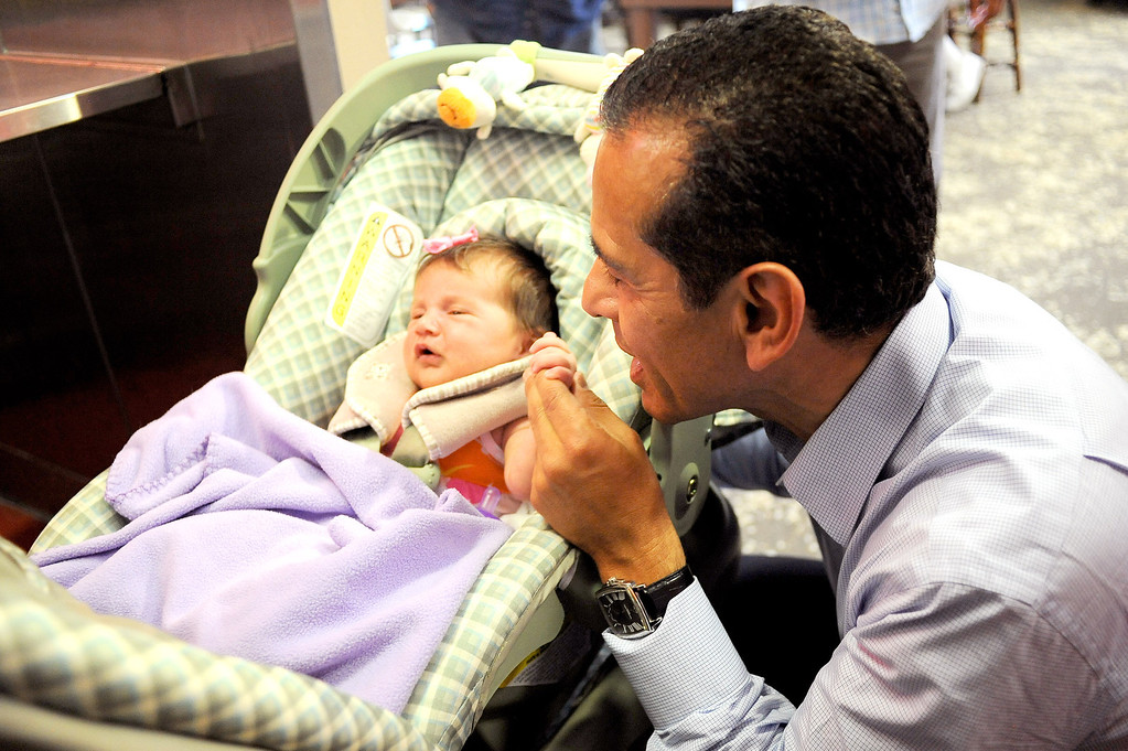 . Mayor Antonio Villaraigosa visits with baby Mary Galloway at Philippe\'s in Los Angeles, CA June 28, 2013.  Villaraigosa spent the day visiting some of his favorite loactions during his 24-hour goodbye tour.(Andy Holzman/Los Angeles Daily News)