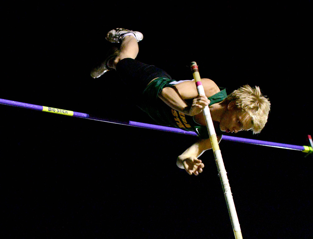 . 05-03-2013-(LANG Staff Photo by Sean Hiller)-  The Bay League track and field finals Friday night at Mira Costa High School. Costa\'s pole vaulter Sean Griffin celebrates a first place win at 15ft.