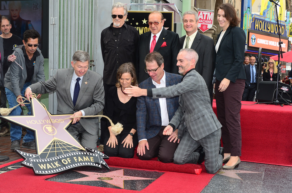 ". Siblings of the late Janis Joplin, Laura and Michael(sitting center), attend her posthumous Hollywood Star ceremony where Kris Kristofferson(back-sunglasses) performed ""Me & Bobby McGee\"", on November 4, 2013 in Hollywood, California. Joplin, would have turned 70 years old this year and is the recipient of the 2,510th Star on the Hollywood Walk of Fame in the Category of Recording.      (FREDERIC J. BROWN/AFP/Getty Images)"