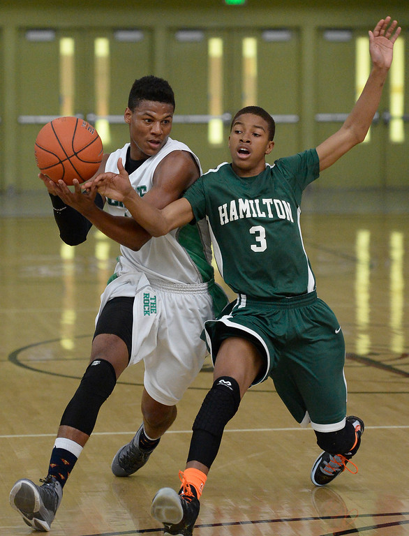 . Eagle Rock#23 Chaevon Gaines tries to drive past Hamilton Micah Moore. The boys from Eagle Rock defeated Hamilton 68-56 in the City Section Division III Boys basketball final. Los Angeles, CA. March 8, 2014 (Photo by John McCoy / Los Angeles Daily News)