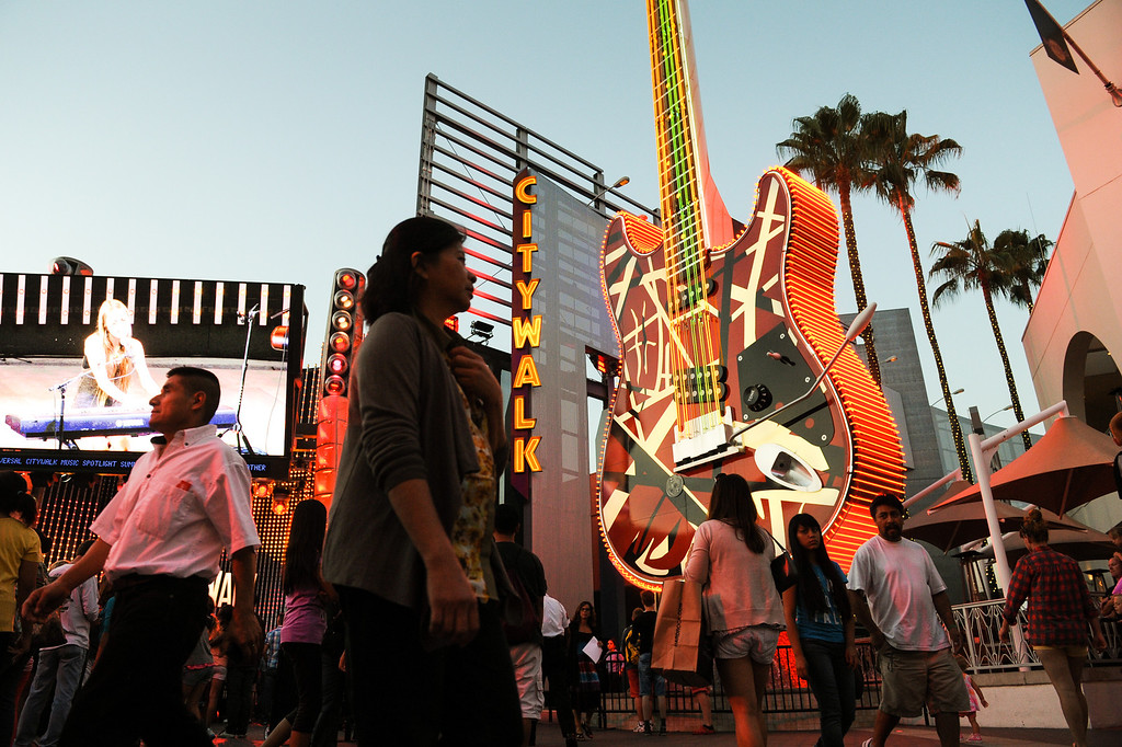 . People walk by the Hard Rock Cafe at Universal CityWalk. Friday, July 6, 2013. (Michael Owen Baker/L.A. Daily News)