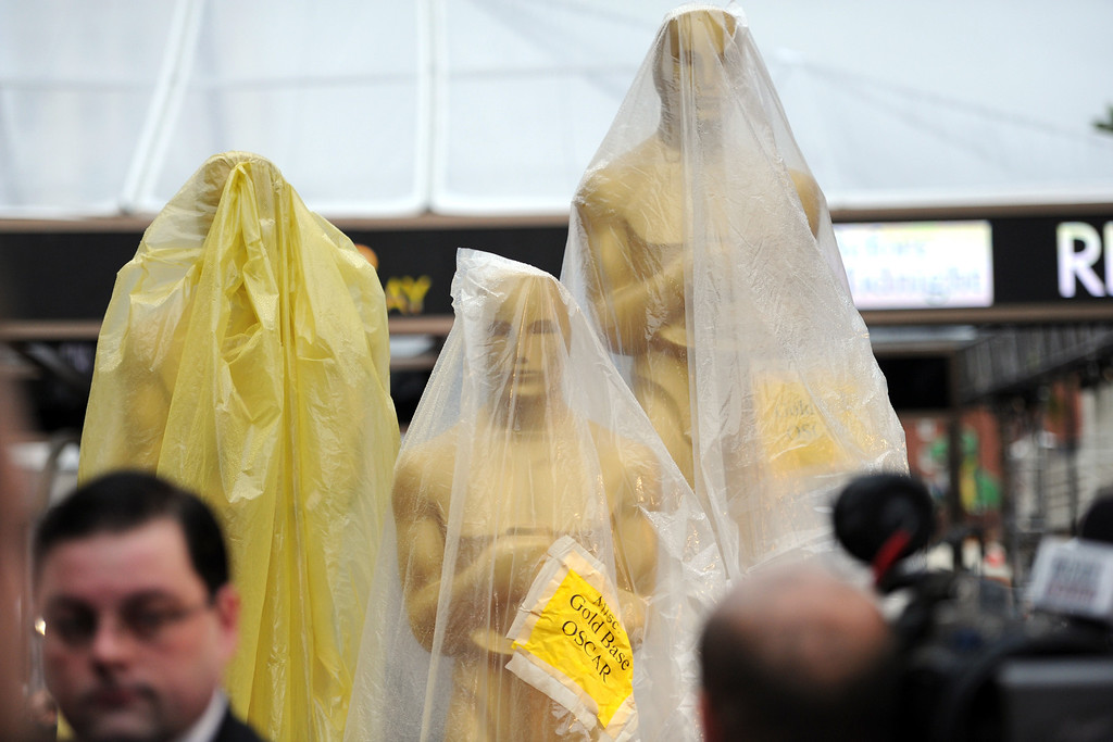. Oscar statues covered in plastic to protect them from the rain.  The 86th Academy Awards at the Dolby Theatre in Hollywood, California on Sunday March 2, 2014 (Photo by John McCoy / Los Angeles Daily News)