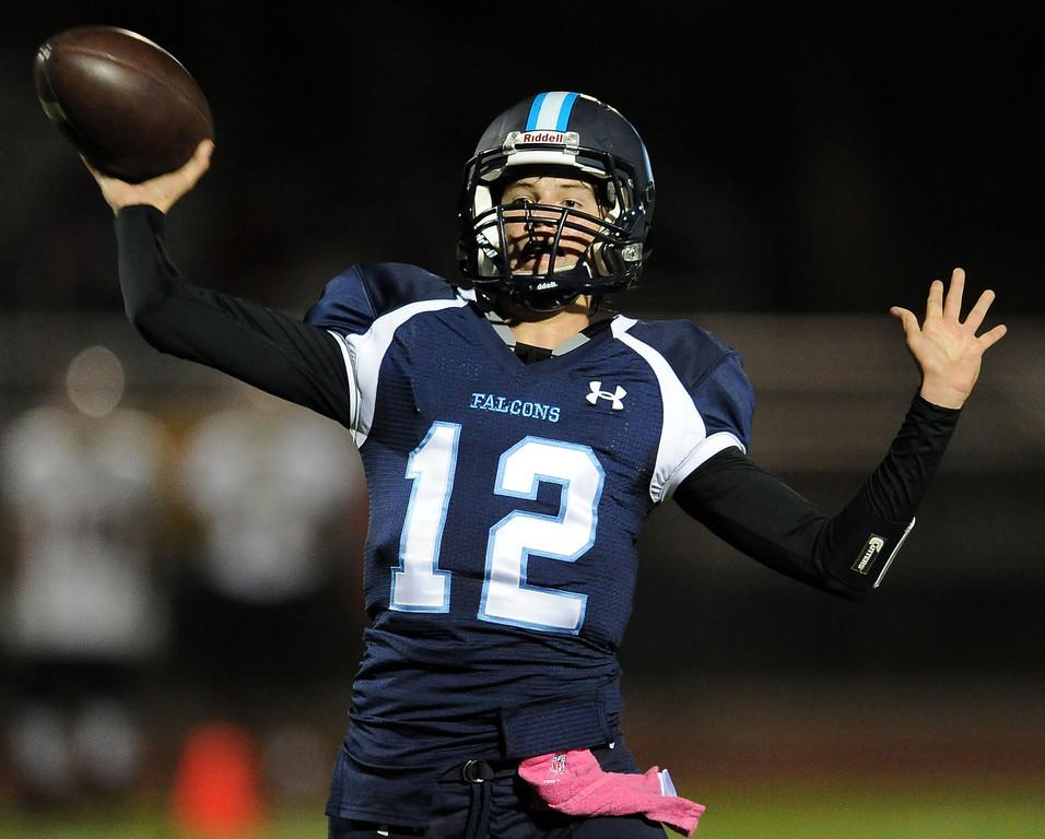 . Duarte quarterback Isaiah Scott passes against Gladstone in the first half of a prep football game at Duarte High School in Duarte, Calif., Thursday, Oct. 10, 2013.    (Keith Birmingham Pasadena Star-News)