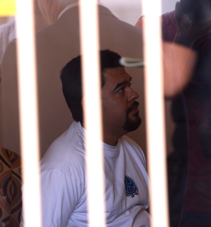 . Co-owner Tomas Dominic Castro, 37, of Highland, is detained by San Bernardino Police as they conduct a raid at a marijuana dispensary along the 3200 block of North E Street in San Bernardino May 9, 2013. GABRIEL LUIS ACOSTA/STAFF PHOTOGRAPHER.