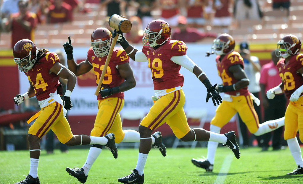 . USC\'s Michael Hutchings carries the hammer as they come onto the field for their game against Utah, Saturday, October 26, 2013, at the L.A. Memorial Coliseum. (Michael Owen Baker/L.A. Daily News)