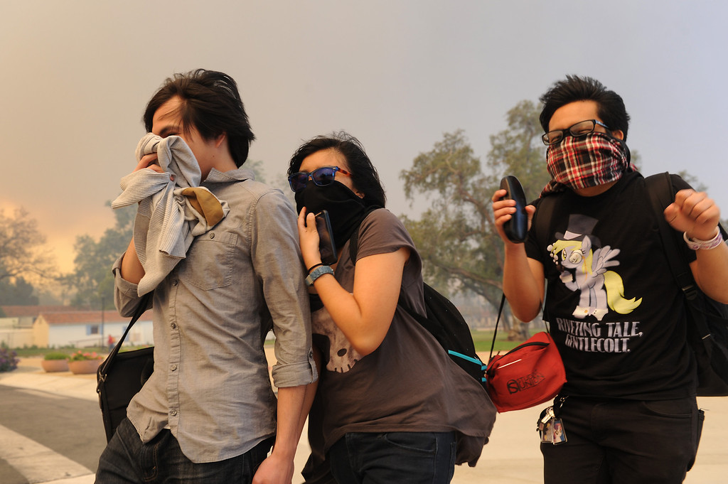 . Students at Cal State University Channel Islands cover their faces from the smoke as the school is evacuated because of the Conejo Fire, Thursday, May 2, 2013. (Michael Owen Baker/Los Angeles Daily News)