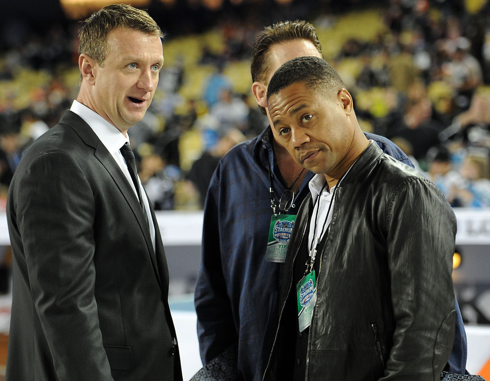 . Actor Cuba Gooding Jr., right, with Los Angeles Kings assistant general manager Rob Blake prior to the start of the inaugural NHL Stadium Series game between the Anaheim Ducks and the Los Angeles Kings at Dodger Stadium in Los Angeles on Saturday, Jan. 25, 2014. (Keith Birmingham Pasadena Star-News)