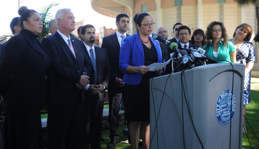 . Assembly member Cristina Garcia (D-Bell Gardens) flanked by many elected officials speaks during a press conference calling for Senator Ron Calderon to resign his position in the California State Senate in front of the Bell Gardens City Hall in Bell Gardens , Calif., on Wednesday, Nov. 13, 2013.
