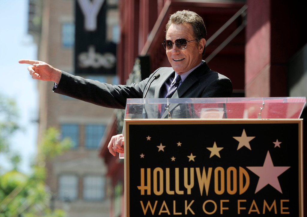 ". Bryan Cranston, star of the television series ""Breaking Bad,\"" addresses the crowd before receiving a star on the Hollywood Walk of Fame on Tuesday, July 16, 2013 in Los Angeles. (Photo by Chris Pizzello/Invision/AP)"