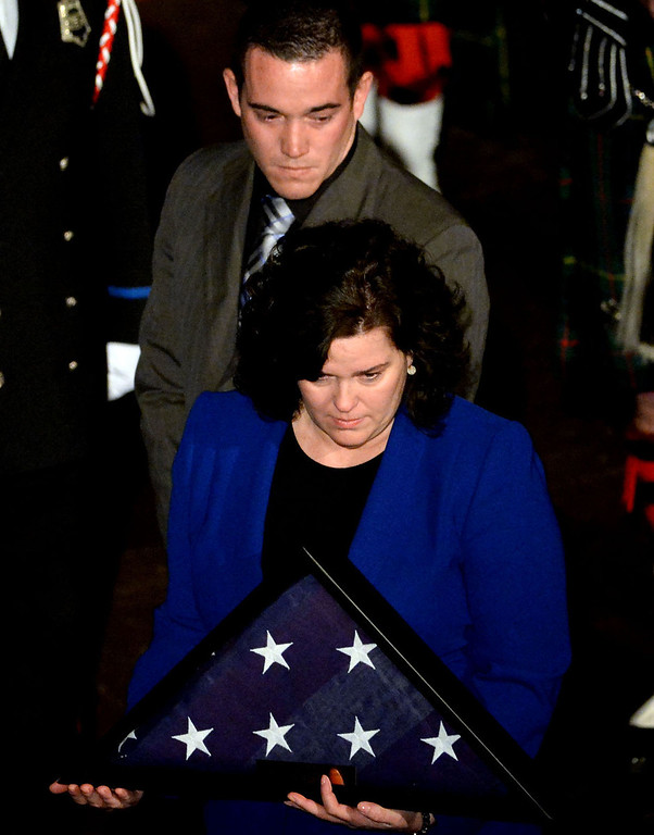 . Shawna Tennant along with brother Brian Tennant after receiving the flag during a celebration of life service for former Pasadena Fire dept. Capt. and California State fire marshall, John Tennant at the Pasadena Civic Auditorium in Pasadena, Calif., on Wednesday, Feb. 5, 2014. (Keith Birmingham Pasadena Star-News)