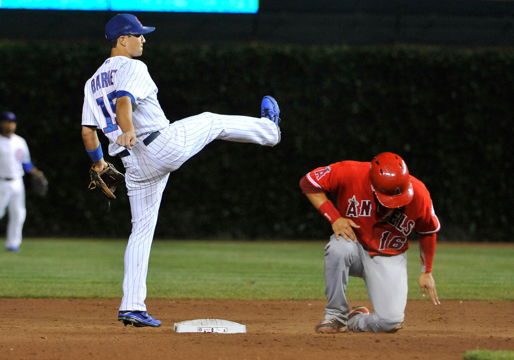 . CHICAGO, IL - JULY 10: Darwin Barney #15 of the Chicago Cubs forces out Hank Conger #16 of the Los Angeles Angels of Anaheim during the ninth inning  on July 10, 2013 at Wrigley Field in Chicago, Illinois. The Los Angeles Angels of Anaheim defeated the Chicago Cubs 13-2. (Photo by David Banks/Getty Images)
