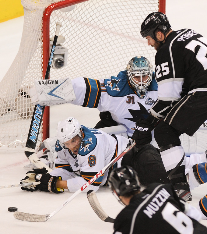 . The Kings\' Dustin Penner shoots against the San Jose Sharks\' Joe Pavelski, and goalkeeper Antti Niemi during the third period, Thursday, May 16, 2013, at Staples Center. (Michael Owen Baker/Staff Photographer)