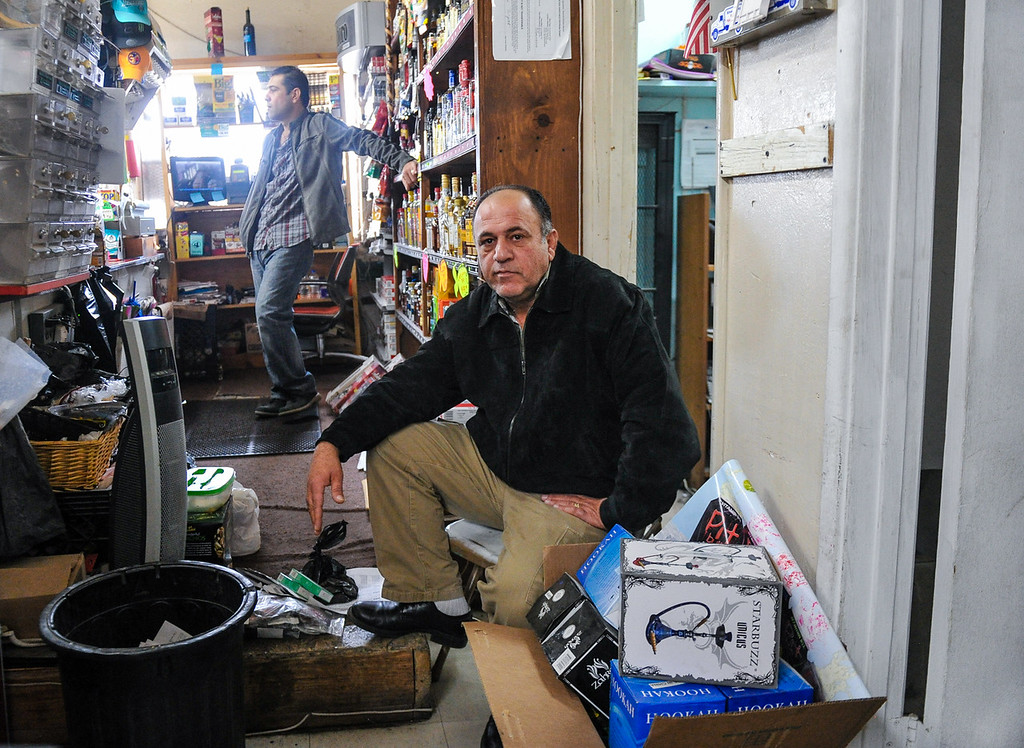 . Ali Abu Hantash, owner of Hinkley Market & Gas, sits and waits for customers to enter his empty general store in Hinkley, Calif. on Thursday, March 7, 2013. Hantash is struggling to keep Hinkley\'s only retail business open, and said he sees no hope to save his store due Hinkley\'s dwindling population. (Rachel Luna / San Bernardino Sun)