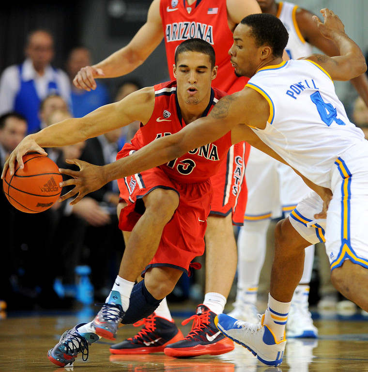 . UCLA\'s Norman Powell tries a steal against Arizona\'s Nick Johnson, Thursday, January 9, 2014, at Pauley Pavilion. (Photo by Michael Owen Baker/L.A. Daily News)