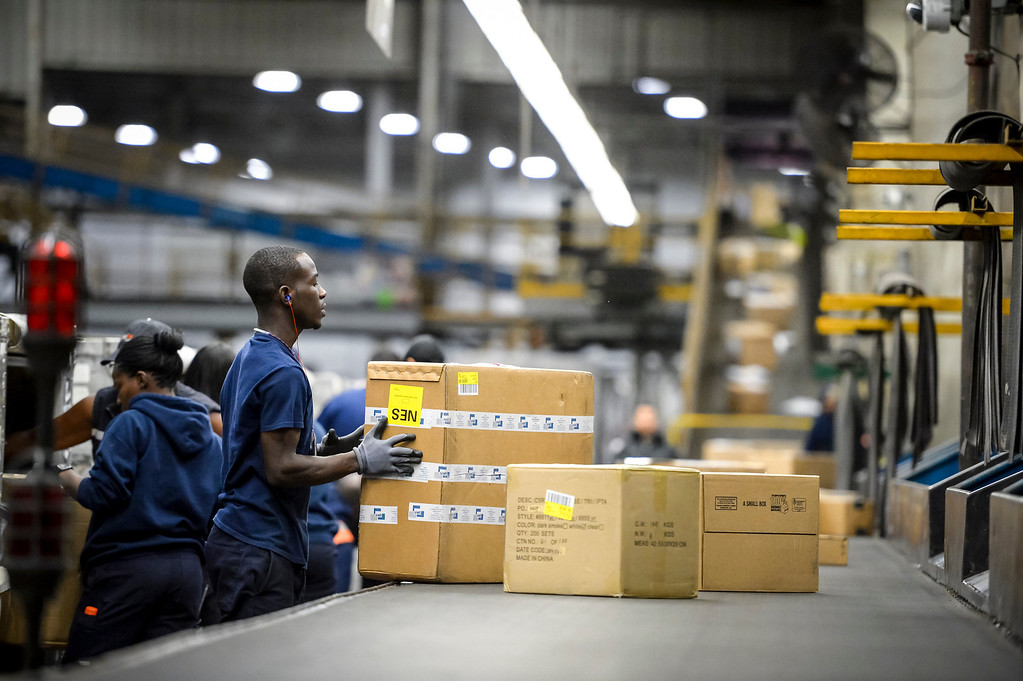 ". Workers at the FedEx LAX Regional Hub sort packages arriving for Southern California on ""Cyber Monday\"", December 2, 2013.  (Photo by David Crane/Los Angeles Daily News)"