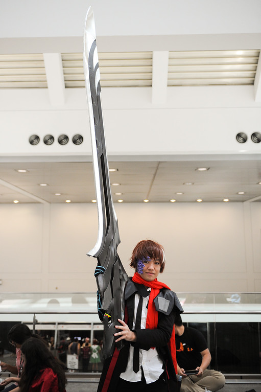 """. Kevin Sakagami holds a large sword while dressed as \""""Shu\"""" from Guilty Crown at the Anime Expo at the L.A. Convention Center, Saturday, July 6, 2013. (Michael Owen Baker/L.A. Daily News)"""