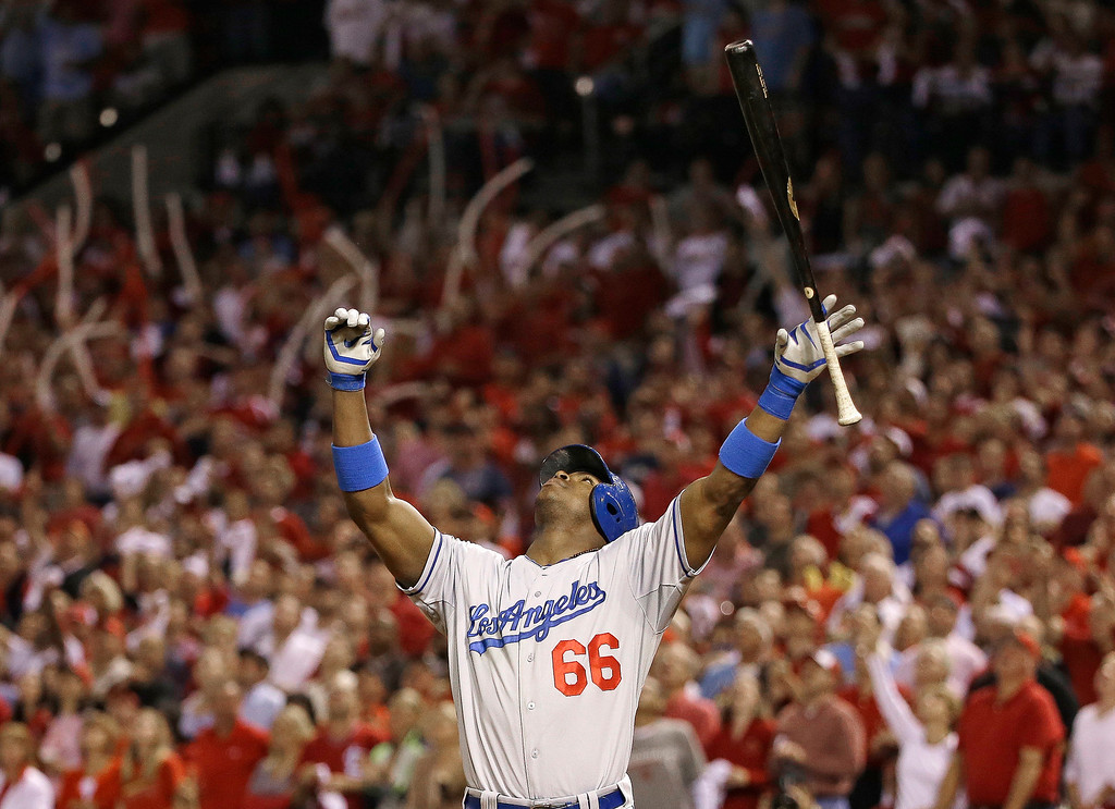 . Los Angeles Dodgers\' Yasiel Puig looks up as he pops out during the fifth inning of Game 1 of the National League baseball championship series against the St. Louis Cardinals, Friday, Oct. 11, 2013, in St. Louis. (AP Photo/David J. Phillip)
