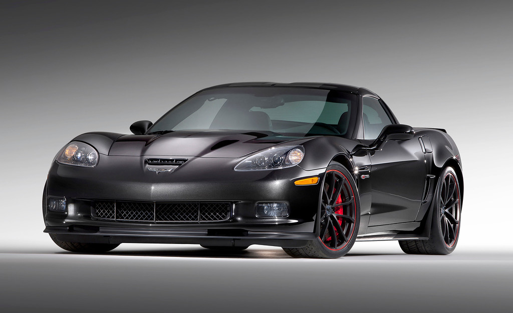 . This product image provided by General Motors, shows a 2012 Chevrolet Corvette Centennial Edition. Corvette�s 2012 Centennial Special Edition includes Carbon Flash Metallic black paint with red accents, unique satin-black lightweight wheels, Ebony interior with red stitching, and �Chevy 100� logos inside and out. (AP Photo/General Motors)