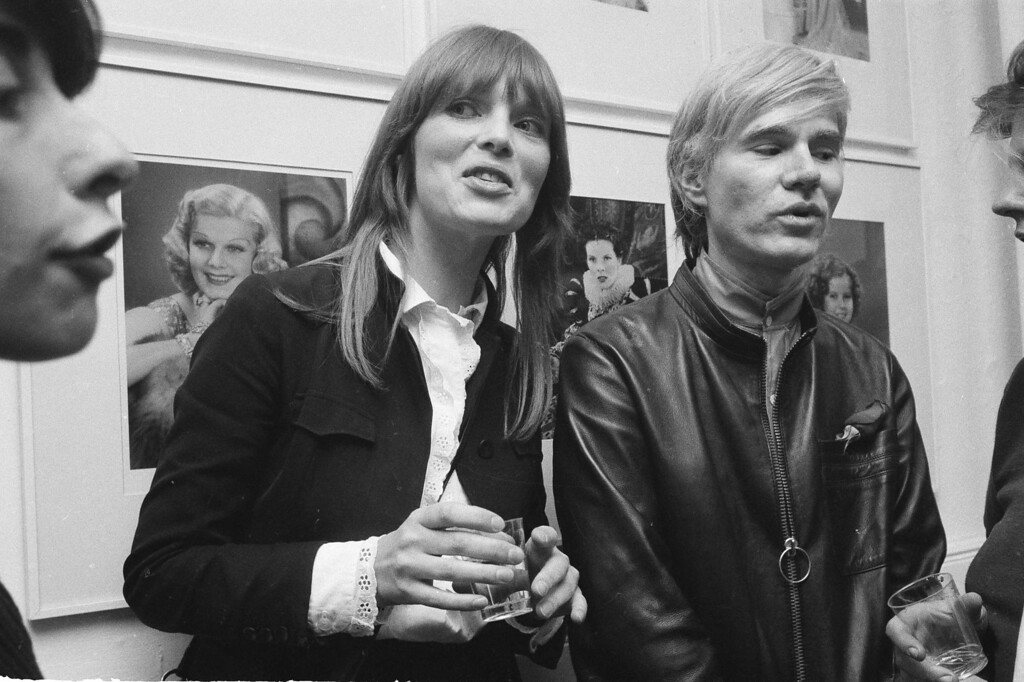 . Artist Andy Warhol, right, is seen with German singer Nico, during a party at his studio, Sept. 19, 1968. (AP Photo/Marty Lederhandler)