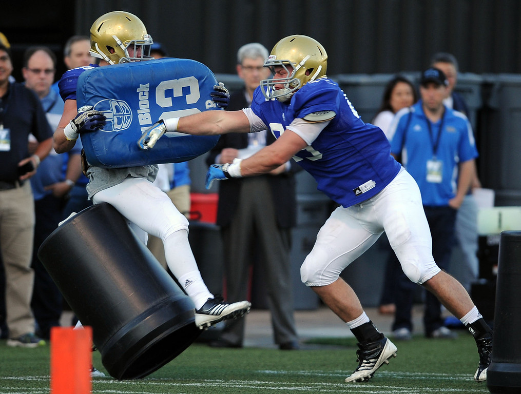 . Players workout during spring practice Monday April 7, 2014 at UCLA.(Andy Holzman/Los Angeles Daily News)