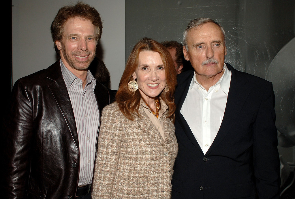 ". LOS ANGELES, CA - MARCH 30:  (L-R) Producer Jerry Bruckheimer, wife Bonnie Bruckheimer and artist/actor Dennis Hopper attend the private opening of Dennis Hopper\'s ""A Survey\"" exhibit held at ACE Gallery on March 30, 2006 in Los Angeles, California.  (Photo by Stephen Shugerman/Getty Images)"