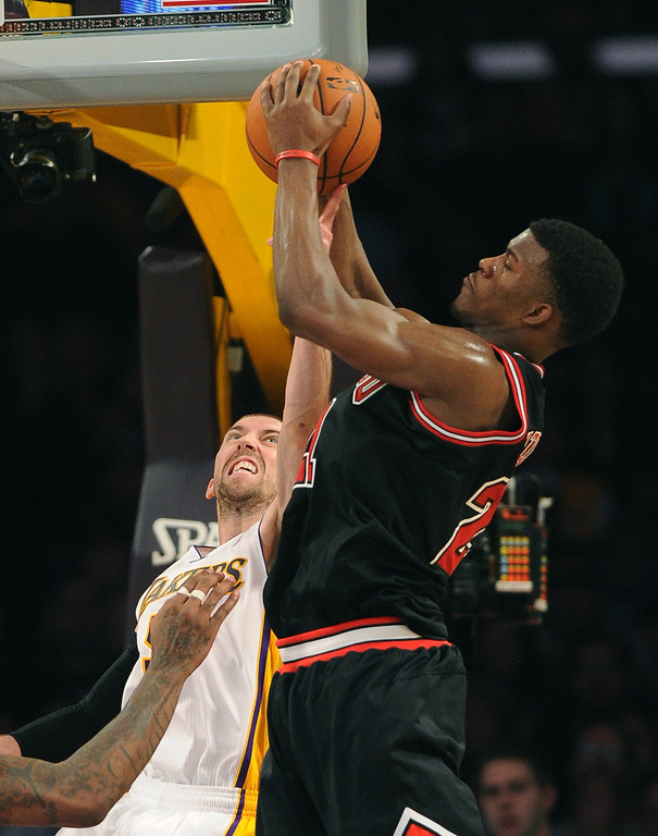 . The Los Angeles Lakers\' Steve Blake guards Chicago Bulls\' Jimmy Butler in the NBA basketball game at Staples Center in Los Angeles, CA. on Sunday, Sunday, February 9, 2014. (Photo by Sean Hiller/ Daily Breeze).