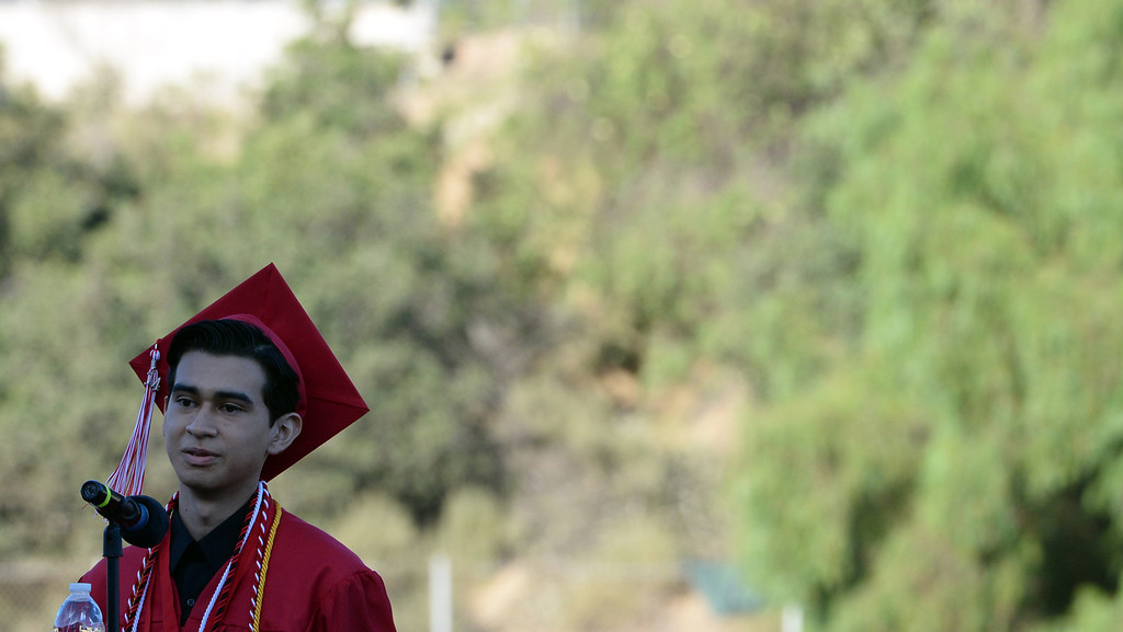 . Valedictorian Carlos Flores speaks during the Whittier High School graduation at Whittier College in Whittier, Calif., on Wednesday, June 4, 2014.  (Keith Birmingham/Pasadena Star-News)