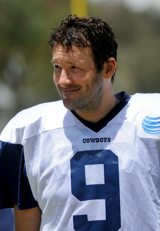 . Cowboys QB Tony Romo smiles as fans ask for autographs following the Cowboys-Raiders practice in Oxnard, Wednesday, August 13, 2014. (Photo by Michael Owen Baker/Los Angeles Daily News)