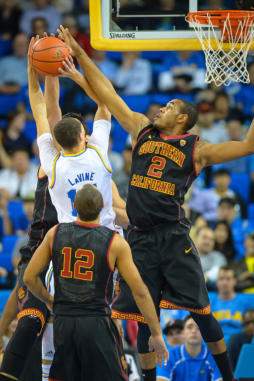. UCLA�s Zach LaVine goes up for two points as USC�s Roschon Prince defends on the play during game action at Pauley Pavilion Sunday, December 5, 2014. UCLA  defeated USC 107-73.  Photo by David Crane/Los Angeles Daily News.