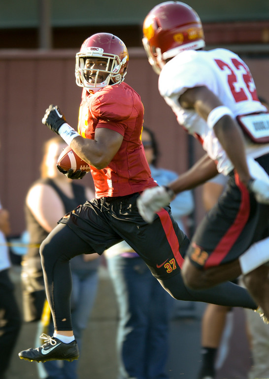 . USC RB Javorius Allen tries to beat DB Leon McQuay III down the sideline at practice, Thursday, March 27, 2014, at USC. (Photo by Michael Owen Baker/L.A. Daily News)