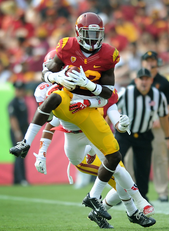 . USC\'s Leon McQuay III intercepts a pass in the second quarter in front of Utah\'s Geoff Norwood, Saturday, October 26, 2013, at the L.A. Memorial Coliseum. (Michael Owen Baker/L.A. Daily News)