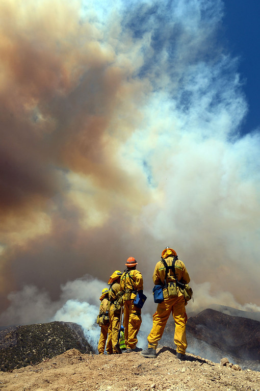 . Firefighters keep an eye on the Powerhouse Fire near Green Valley, CA Friday, May 31, 2013.(Andy Holzman/Staff Photographer)
