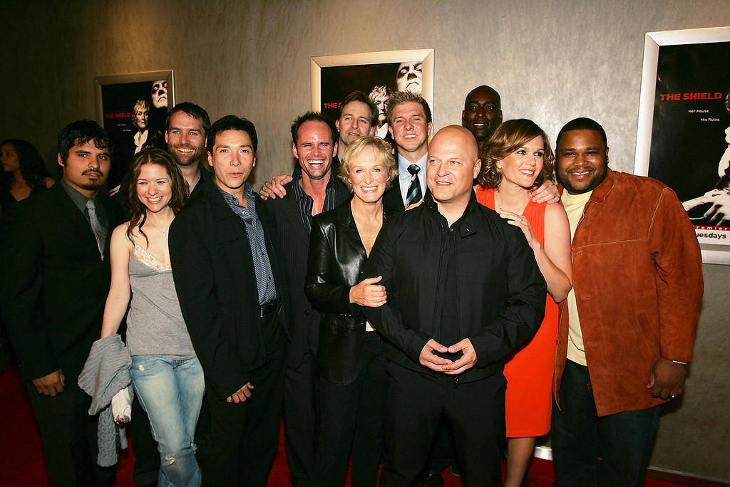 """. The cast of \""""The Shield\"""", with Michael Chiklis in front and (L-R) Michael Pena, Cathy Cahlin Ryan, Benito Martinez, Walton Goggins, Jay Karnes, Glenn Close, Kenny Johnson, Michael Jace, Catherine Dent and Anthony Anderson pose at the 4th season premiere screening of FX\'s \""""The Shield\"""" at the Pacific Design Center on March 12, 2005 in West Hollywood, California. (Photo by Kevin Winter/Getty Images)"""