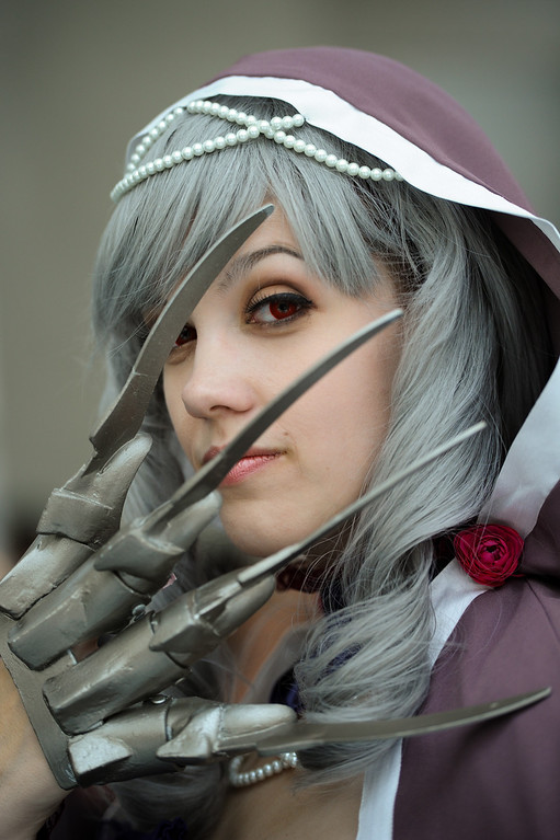 """. Sarah Franchello shows her claws as she is dressed as \""""Viola\"""" from Soul Caliber 5 at the Anime Expo at the L.A. Convention Center, Saturday, July 6, 2013. (Michael Owen Baker/L.A. Daily News)"""