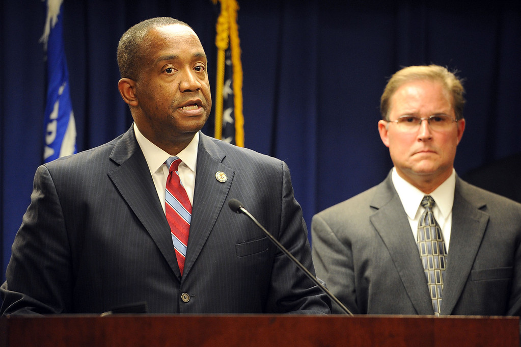 . Bill Lewis, Assistant Director of FBI\'s Los Angeles Office, looks on as United States Attorney Andre Birotte Jr. holds a press conference to announce that 18 members of the L.A. County Sheriff\'s Department are being charged with federal crimes including illegal beatings of jail inmates and obstruction of justice Monday, December 9, 2013 in Los Angeles, CA.  Federal authorities made the announcement after 16 of the defendants were taken into custody earlier today.(Andy Holzman/Los Angeles Daily News)
