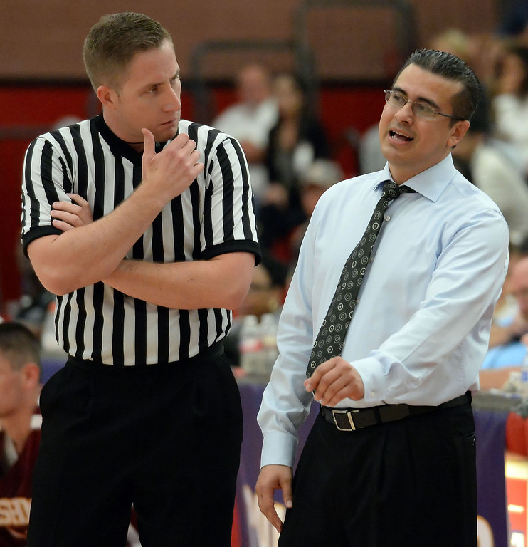 . Cantwell head coach George Zedan talks with a official in the first half of a CIF Southern California Regional Division IV basketball game against Bishop Montgomery at Colony High School in Ontario, Calif., on Saturday, March 22, 2014.  (Keith Birmingham Pasadena Star-News)