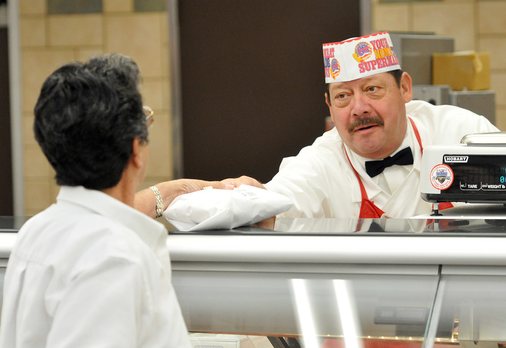 . (John Valenzuela/Staff Photographer) Meat Manager Danny Torrez,  helps a customer at the new Stater Bros. in Redlands during the grand opening of the grocery store, Wednesday, September 25, 2013. The new store replaces the one directly across the street, offering more amenities and services, including a bakery, seafood counter and wider aisles.
