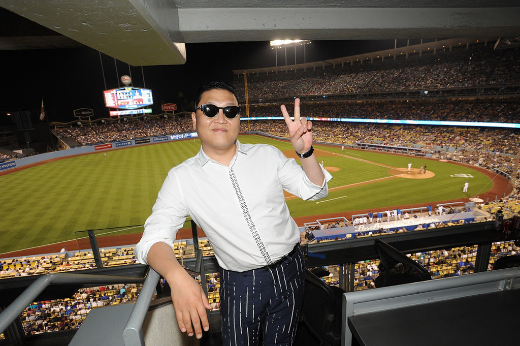 . In this handout photo provided by the Los Angeles Dodgers, Psy attends the Cincinnatti Reds versus Los Angeles Dodgers game at Dodger Stadium on July 27, 2013 in Los Angeles, California.  (Photo by Jon Soohoo/Los Angeles Dodgers via Getty Images)