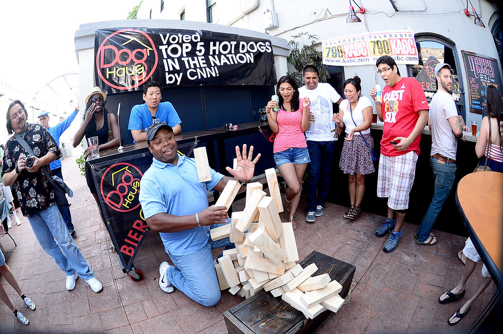 . Retired Navy Commander Jerald Lacy, of Pasadena, plays a life size Jenga at Dog Haus Biergarten in Old Pasadena Saturday, July 6, 2013 before they held their First Annual Hot Dog Eating Competition.  (SGVN/Staff Photo by Sarah Reingewirtz)