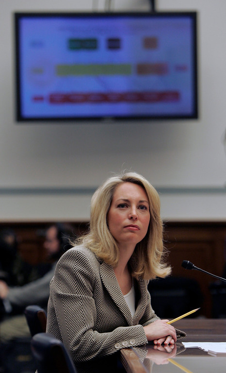 . Former CIA operative Valerie Plame looks up at a television monitor while testifying on Capitol Hill in Washington, Friday, March 16, 2007, before the House Oversight and Government Reform Committee. (AP Photo/Susan Walsh)