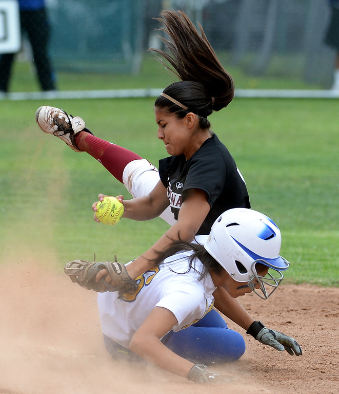 . La Serna second baseman Raeanne Martinez forces out Bishop Amat\'s Alyssa Barrera at second base in the third inning of a prep playoff softball game at Bishop Amat High School in La Puente, Calif., on Thursday, May 22, 2014. La Serna won 6-0.   (Keith Birmingham/Pasadena Star-News)