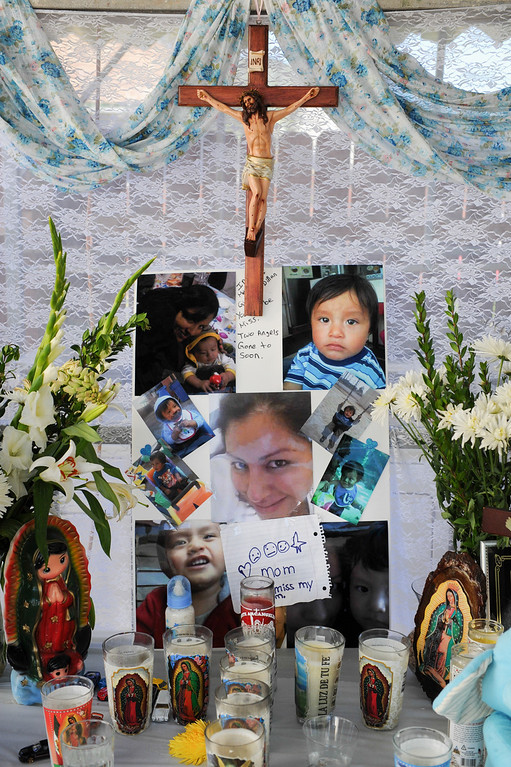 . A memorial for Gissella Yauli and her 19-month-old son, Dillan Reyes who died last week in a garage fire in their South Los Angeles home. (Photo by Michael Owen Baker/L.A. Daily News)